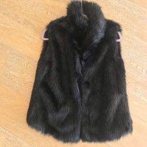 BB Dakota black faux fur vest.